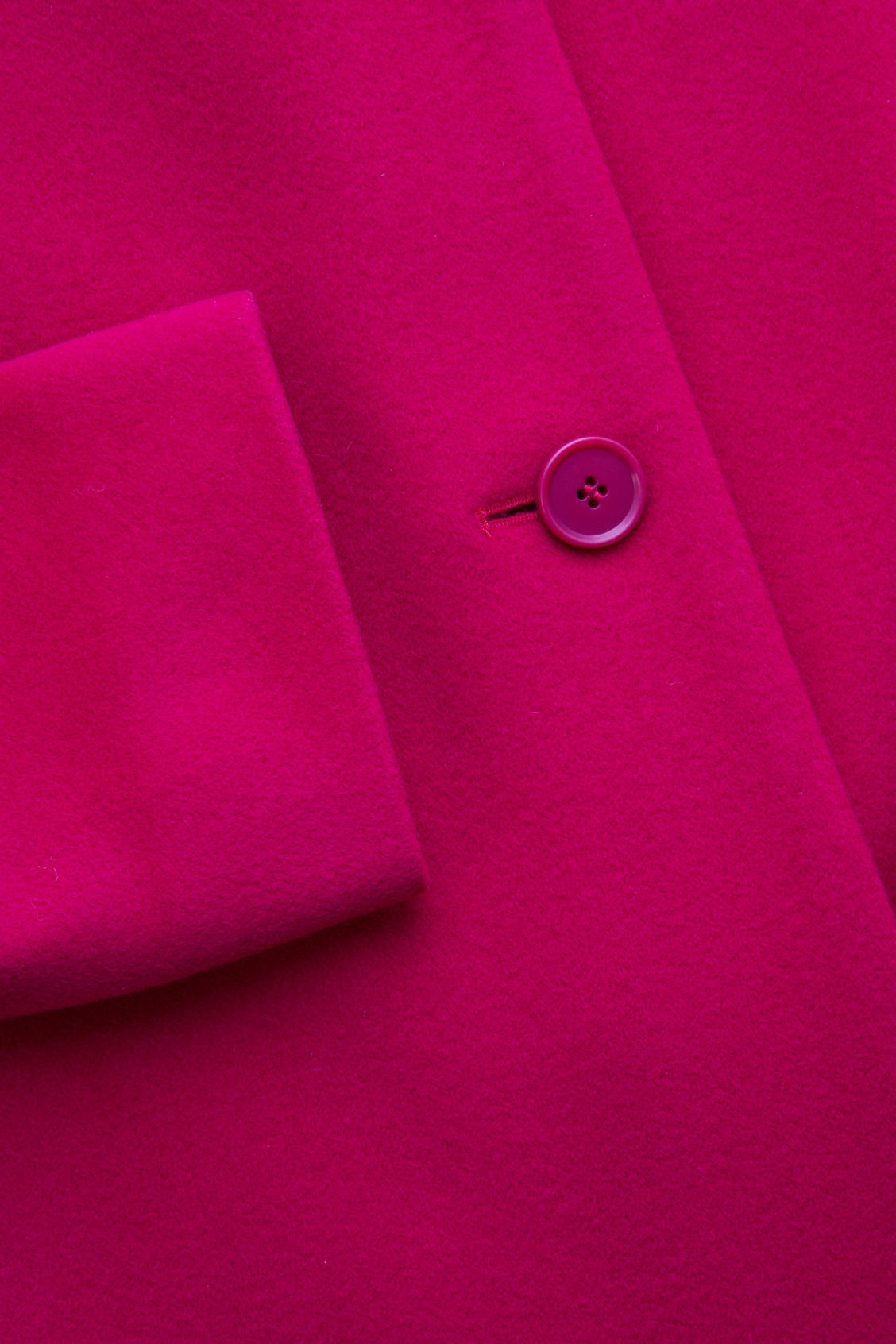 Side image of Cos coat with oversized lapels in pink