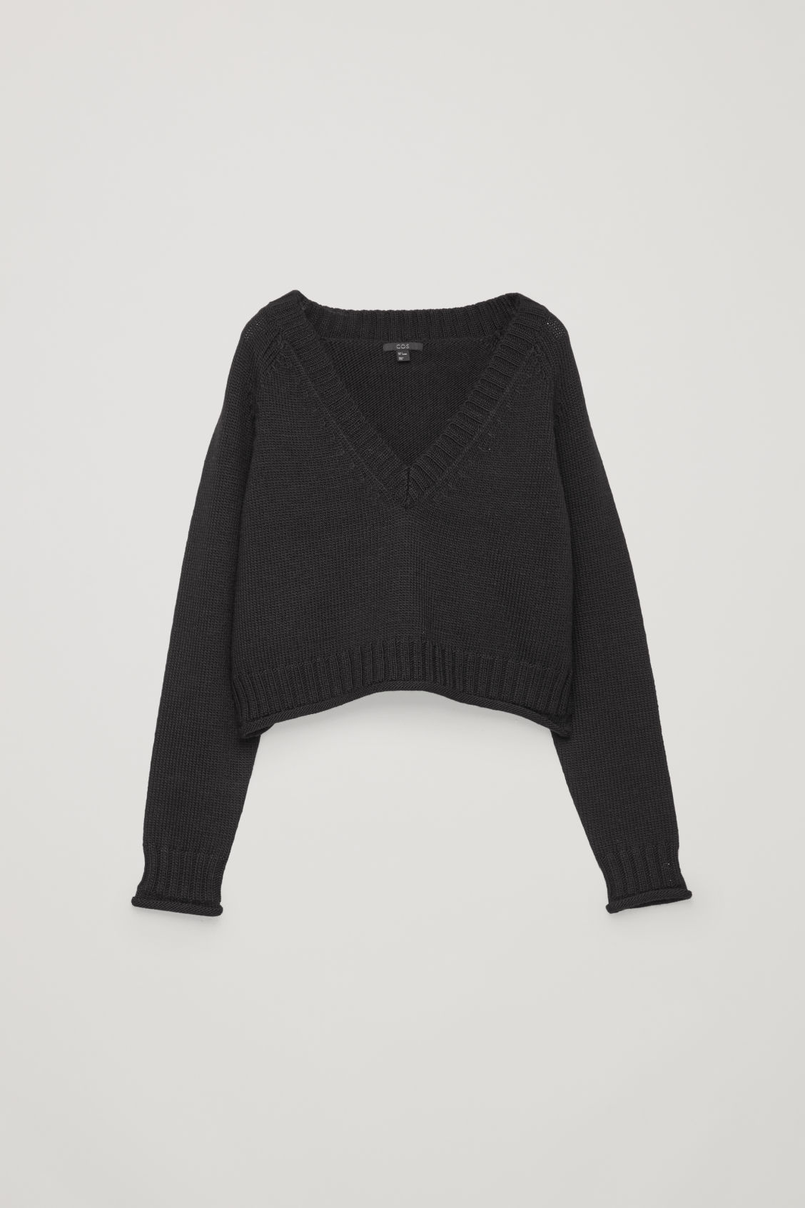 Front image of Cos crop wool v-neck jumper in black