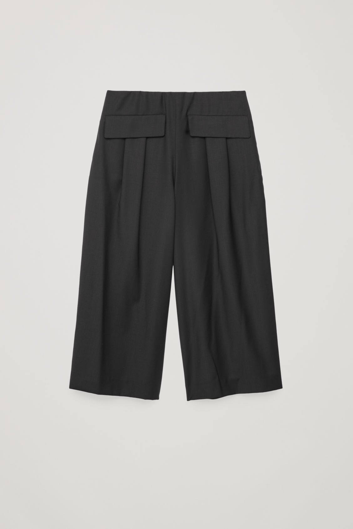 Front image of Cos voluminous trousers in black