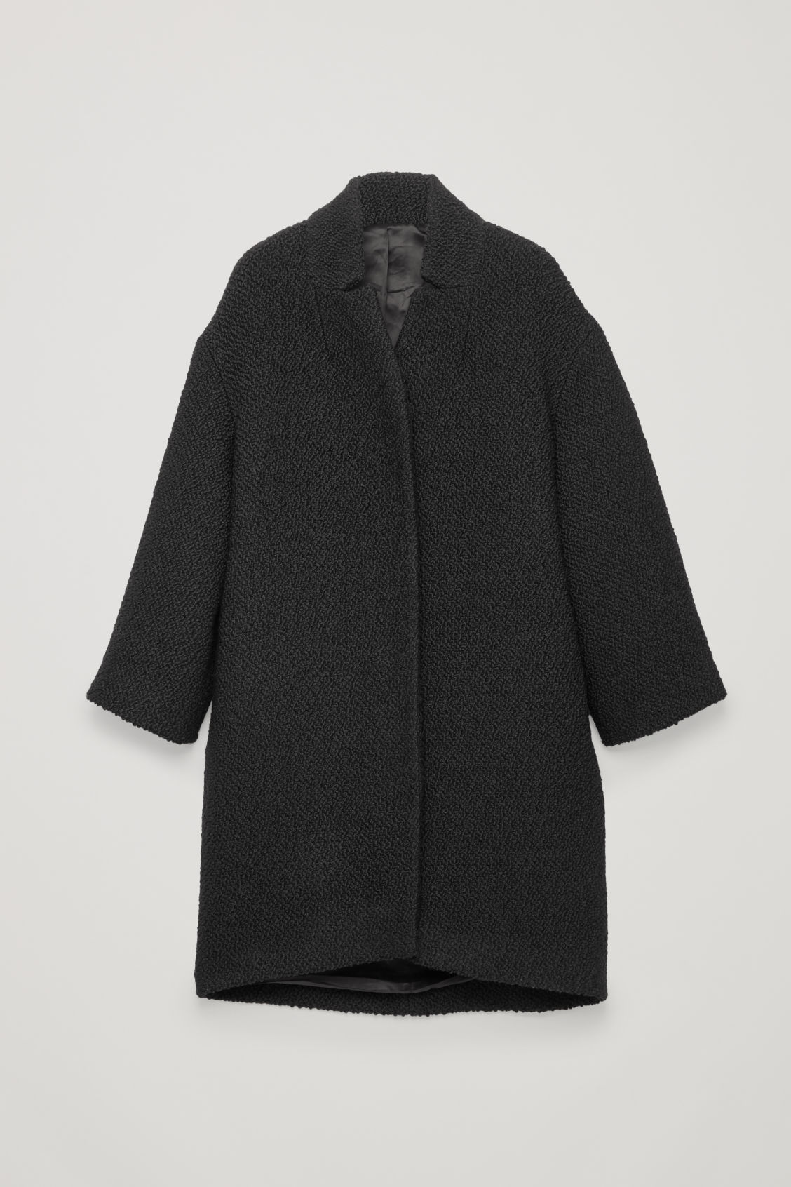 Front image of Cos boucle-wool cocoon coat in black
