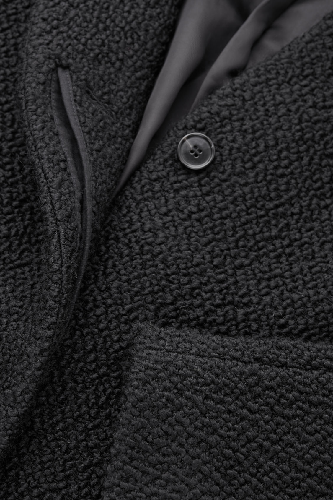 Side image of Cos boucle-wool cocoon coat in black