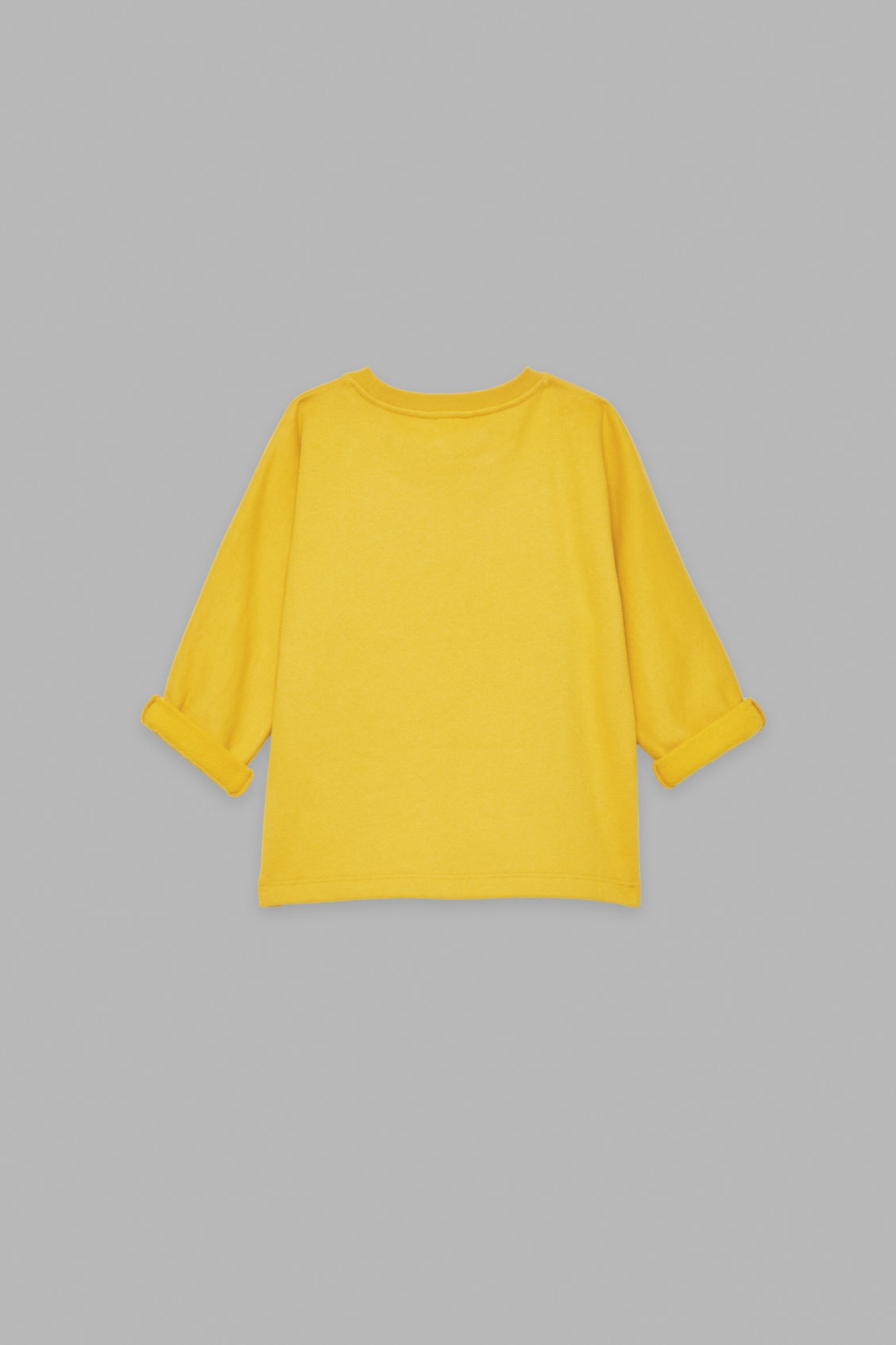 Side image of Cos relaxed jersey jumper in yellow