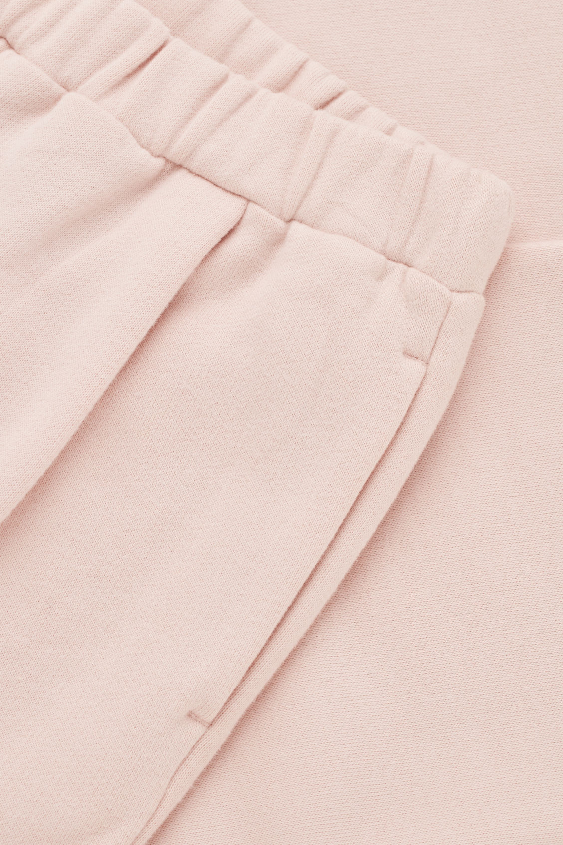 Side image of Cos relaxed jersey trousers in pink