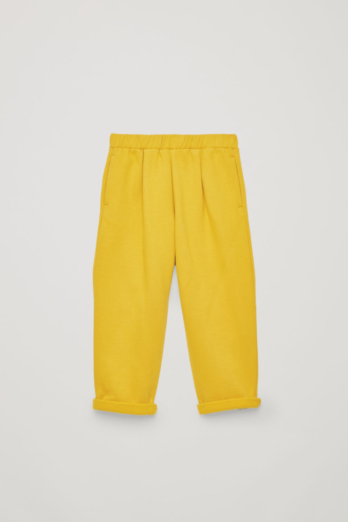 Front image of Cos relaxed jersey trousers in yellow
