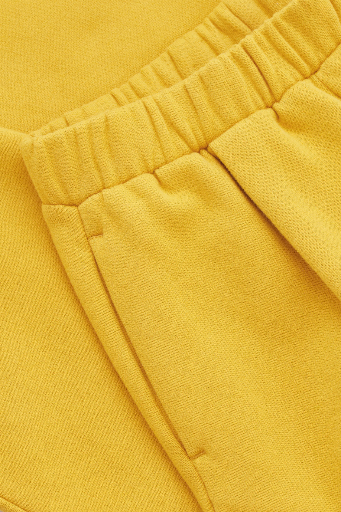Side image of Cos relaxed jersey trousers in yellow