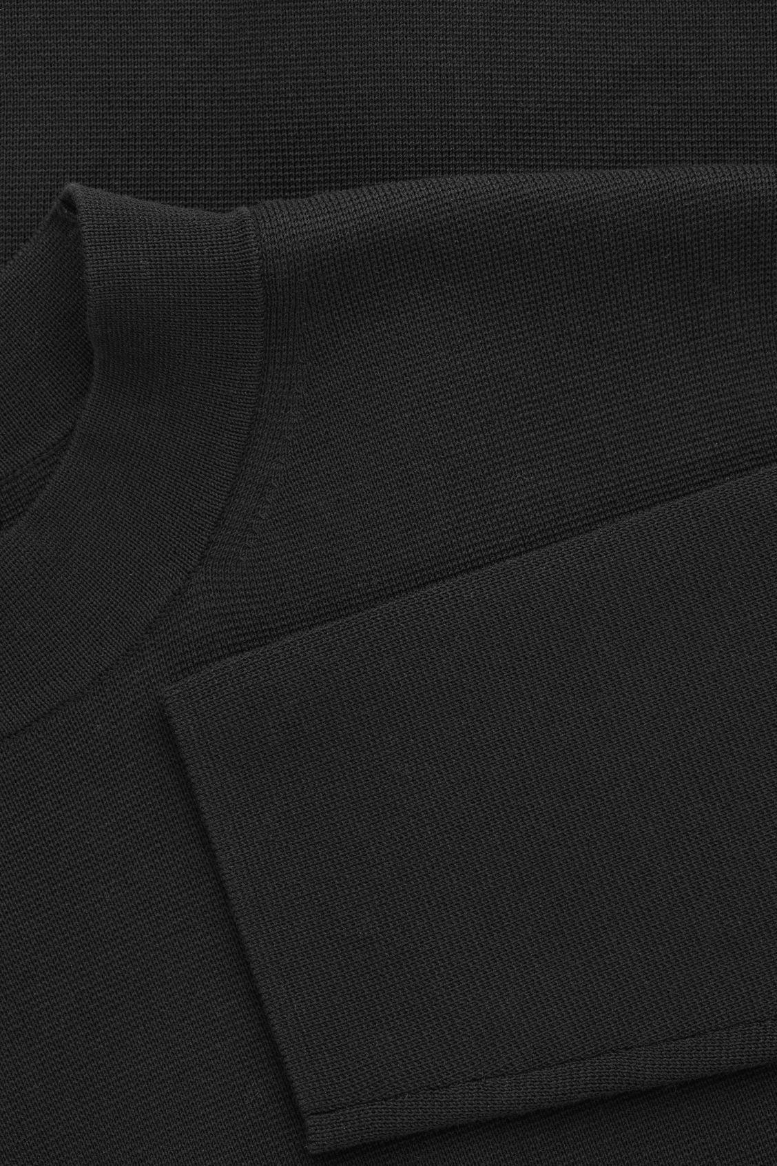 Side image of Cos mock-neck knitted jumper in black