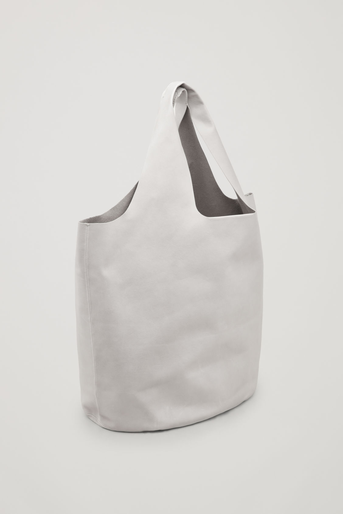 Side image of Cos soft leather tote bag in brown