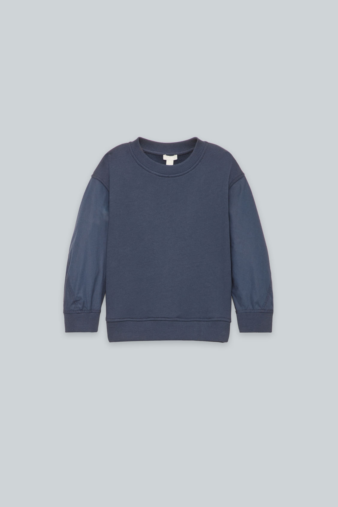Front image of Cos woven-jersey mix jumper in blue
