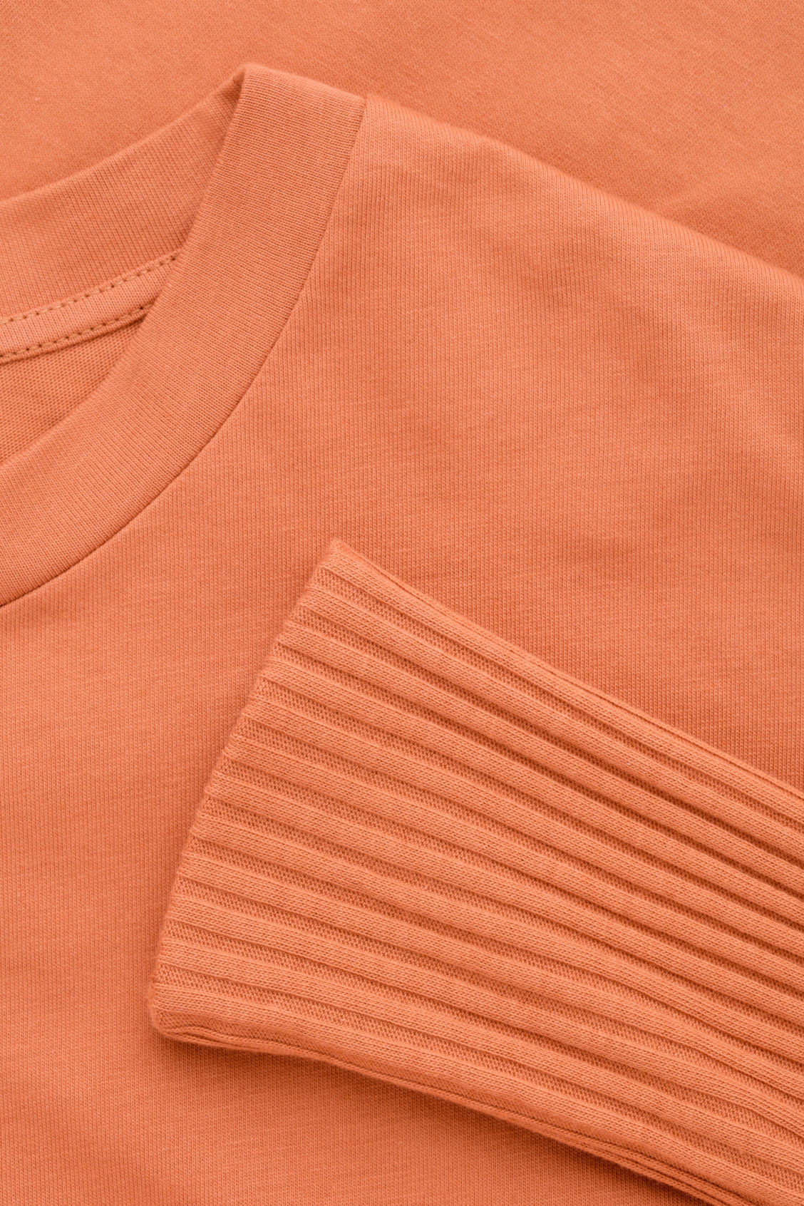 Side image of Cos circle-cut top with rib sleeves in orange