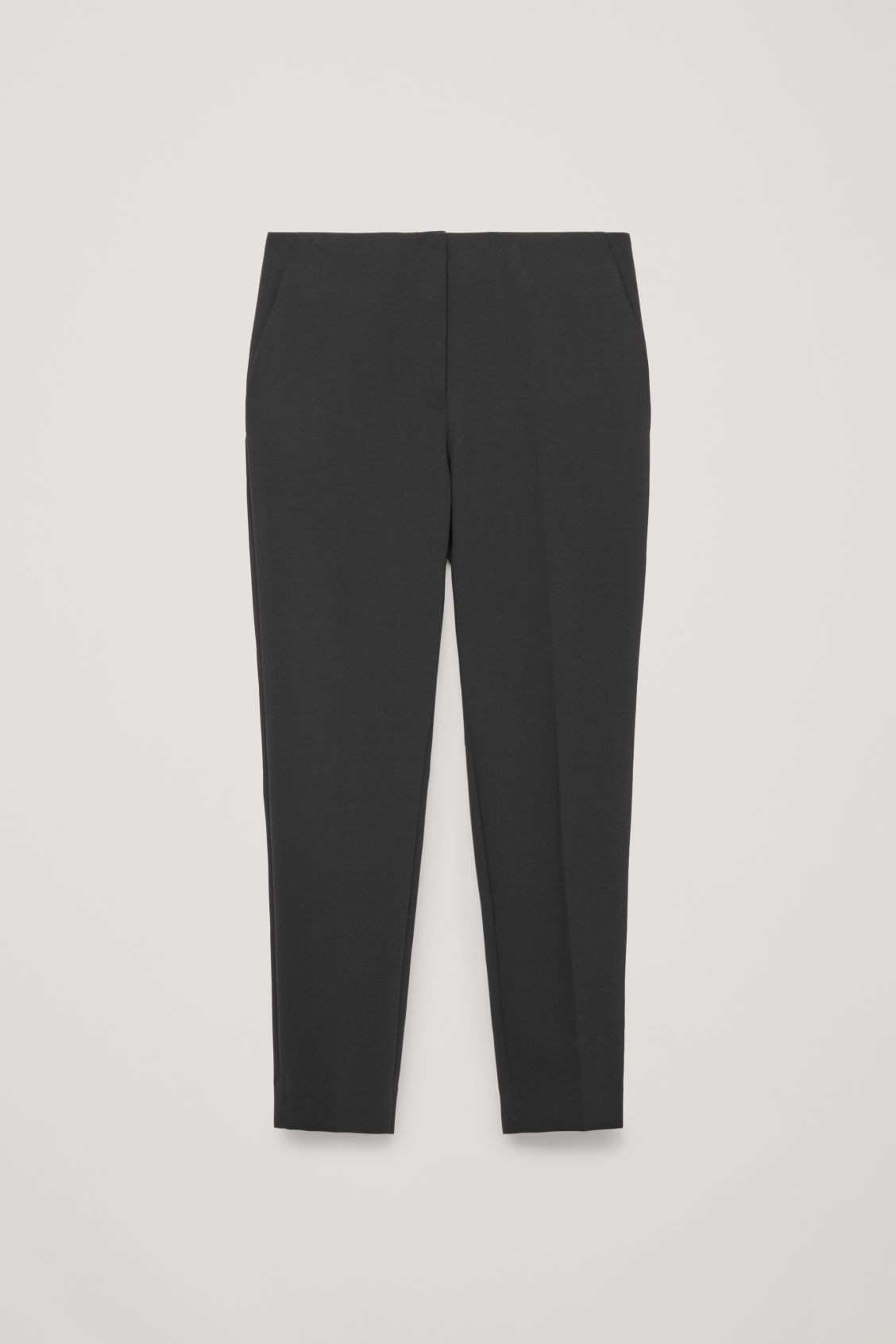 Front image of Cos stretch-wool tailored trousers  in black