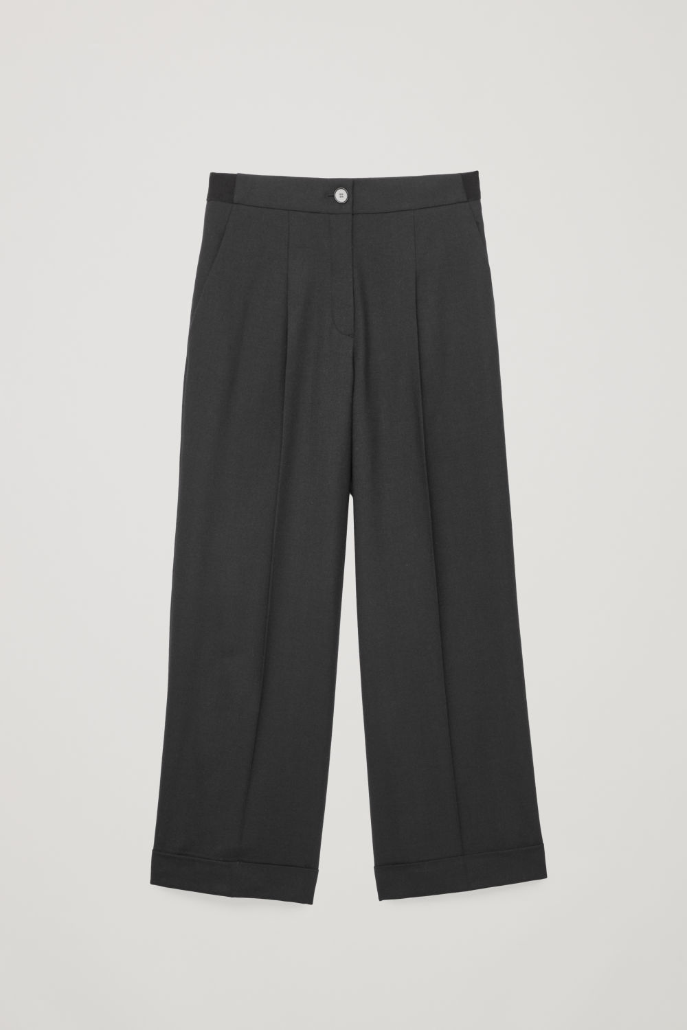 Front image of Cos turn-up wool trousers in black