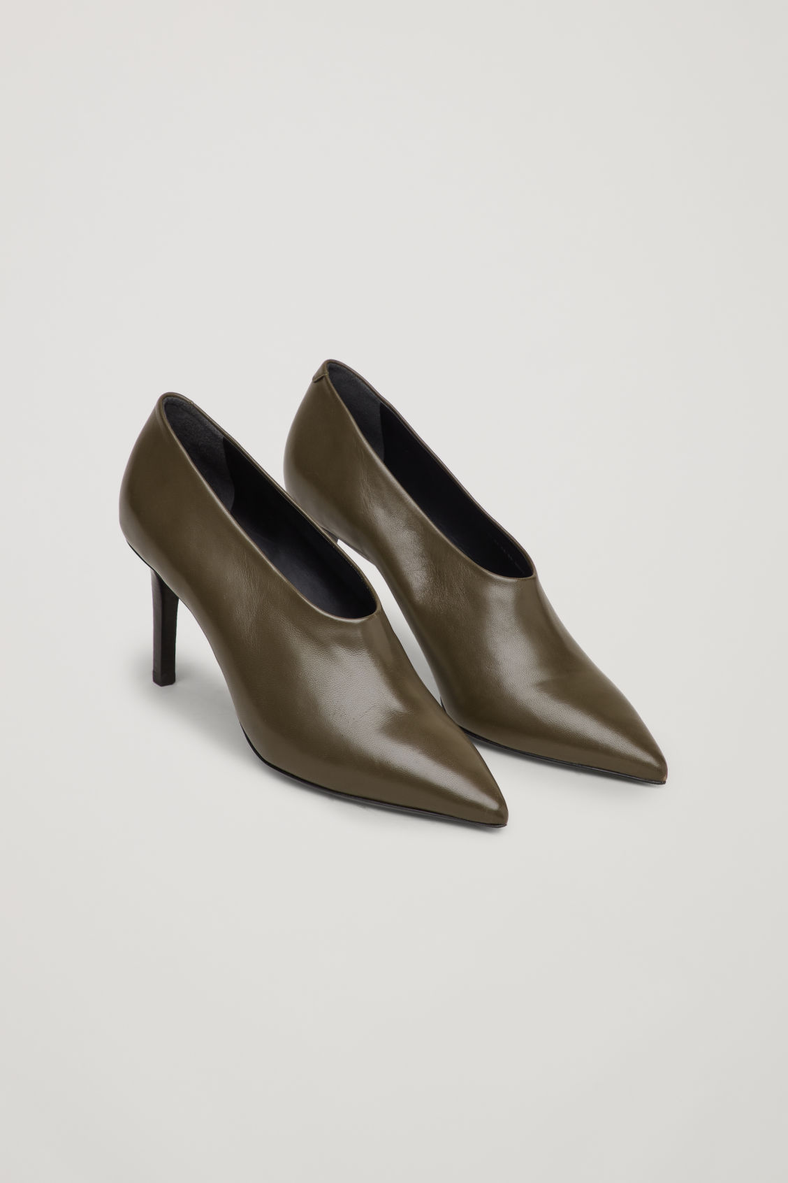 Front image of Cos pointed leather heels in green