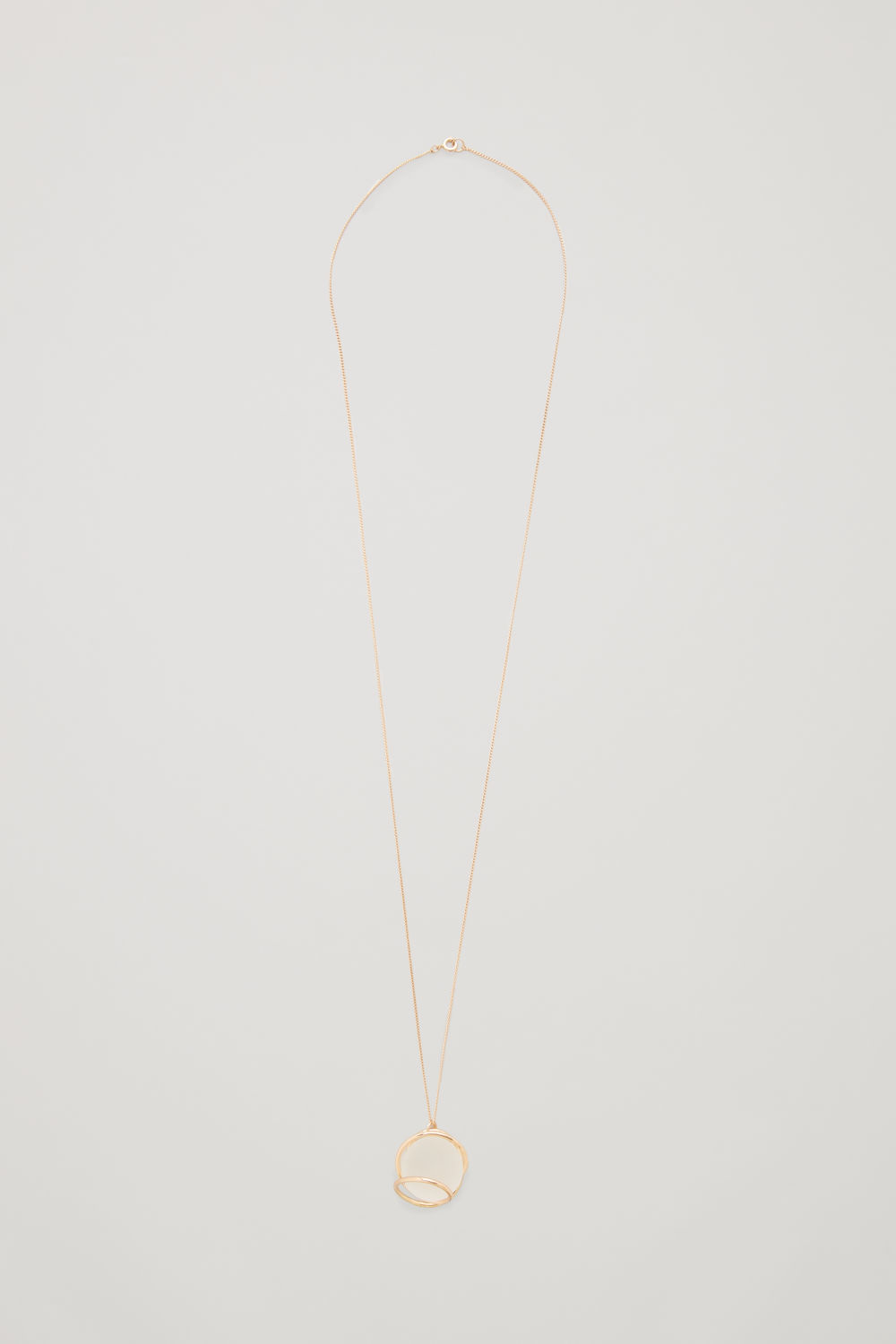 Front image of Cos circle-wire pendant necklace in gold