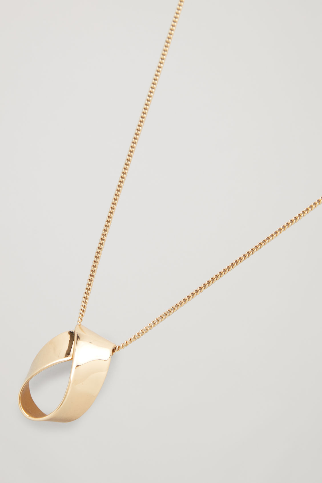 Side image of Cos folded pendant chain necklace in gold