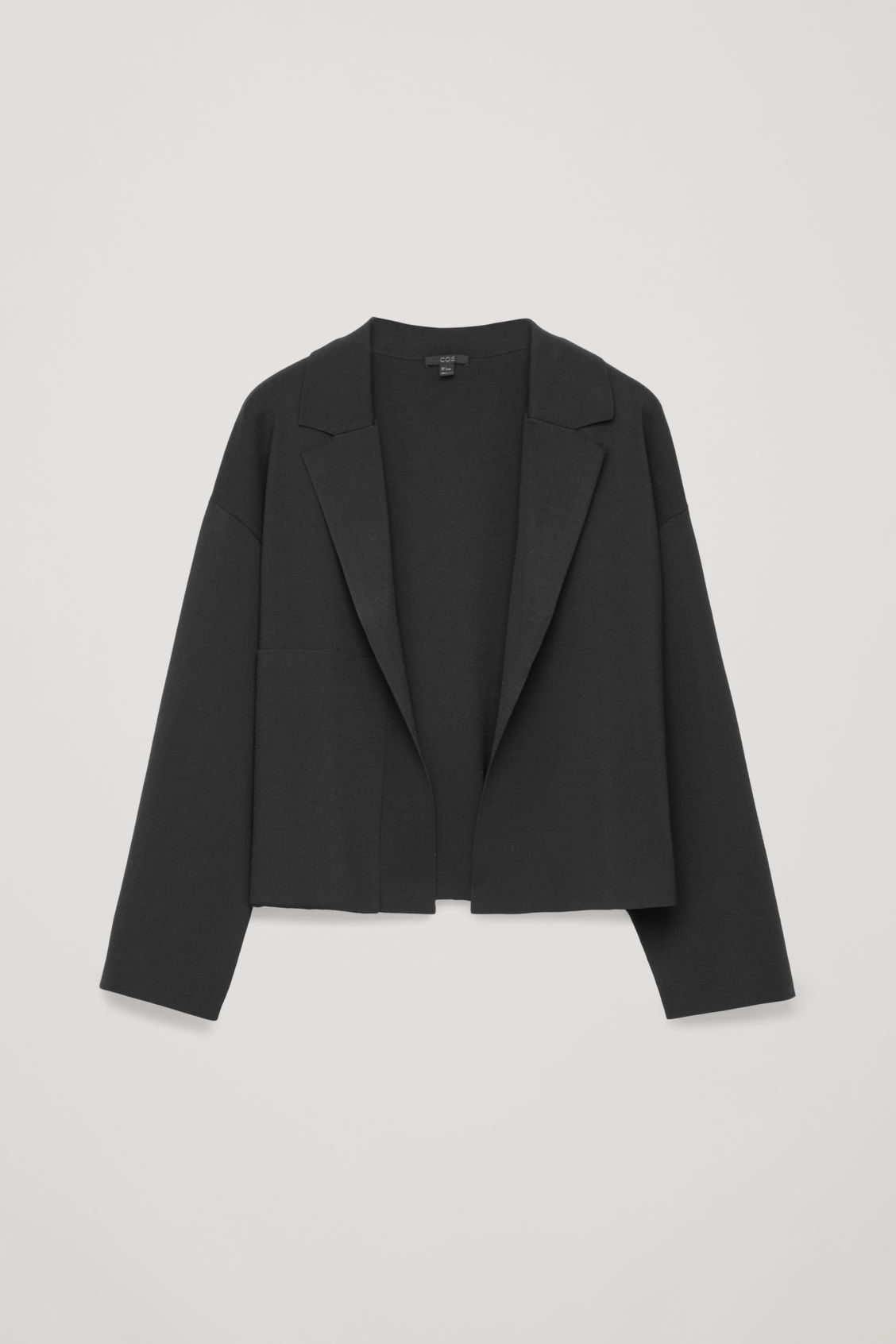 Front image of Cos knitted jacket with pocket in black