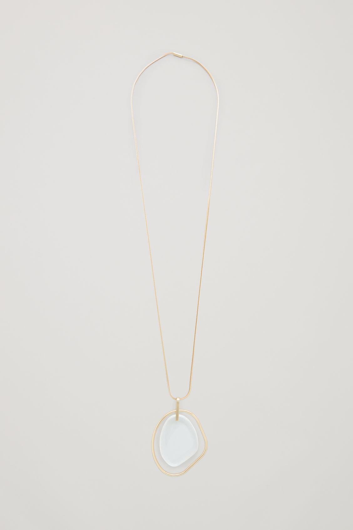 Front image of Cos long glass pendant necklace  in gold