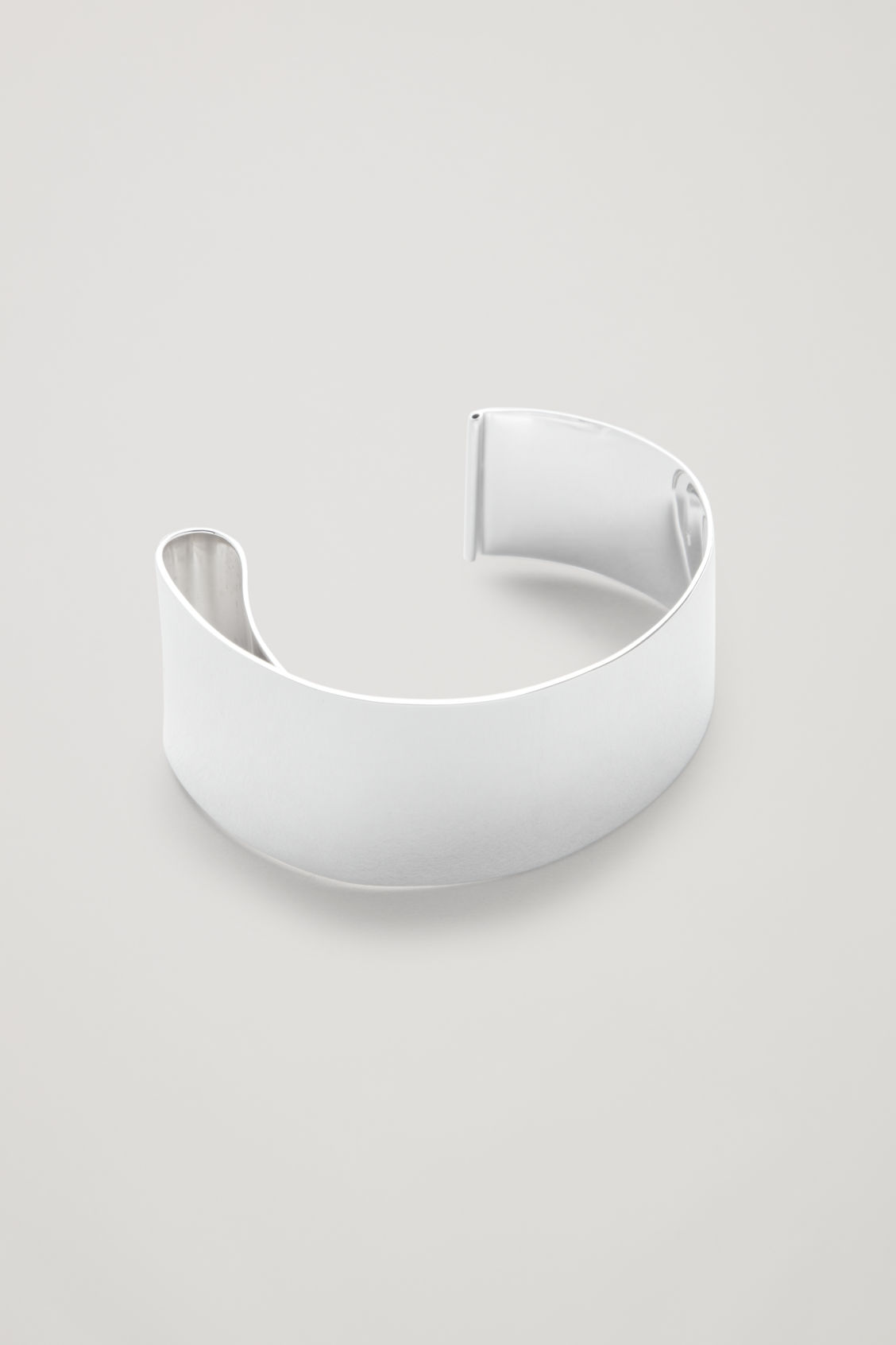 Side image of Cos sterling silver bangle in silver