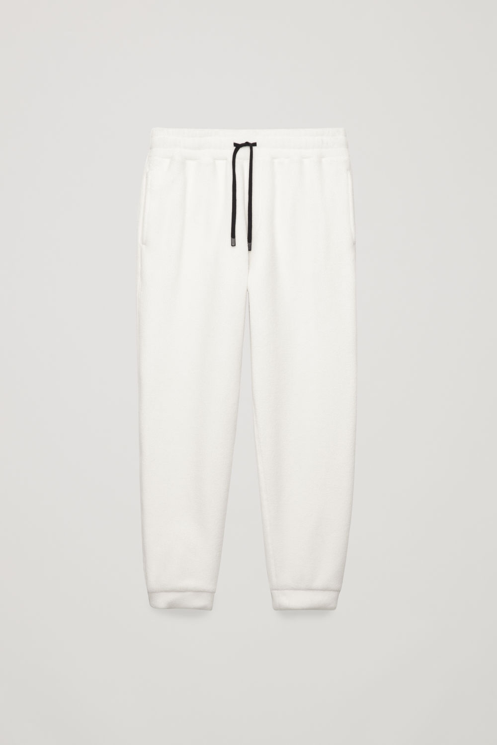 Front image of Cos fleeced trousers in white