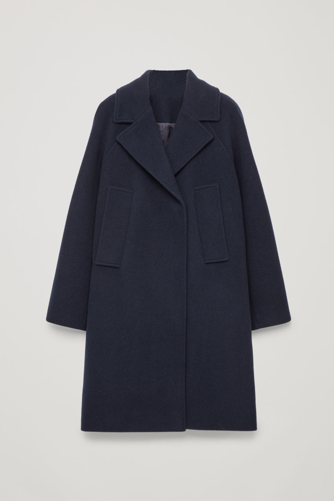 Front image of Cos long double-breasted coat in blue