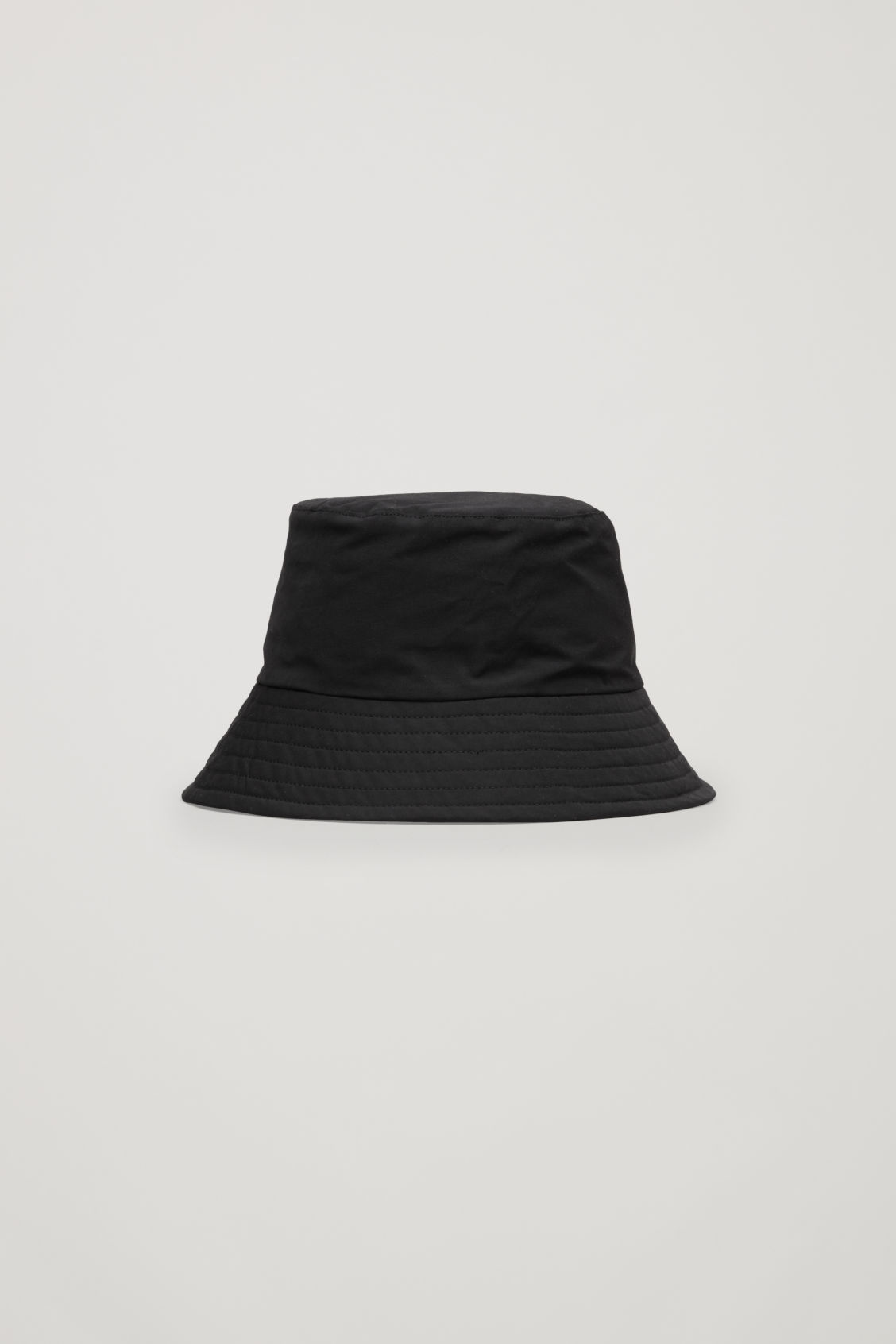 Front image of Cos padded waxed-cotton bucket hat in black