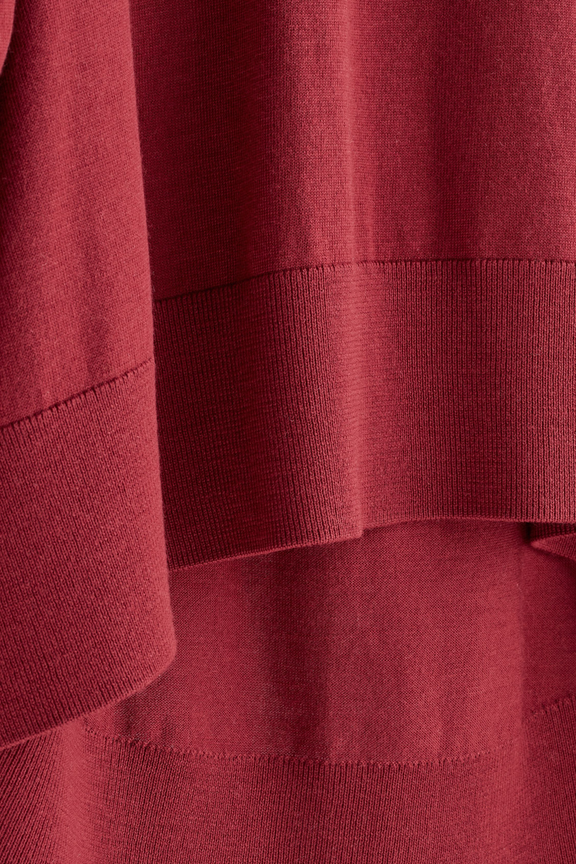 Side image of Cos draped fine-knit wool jumper in red