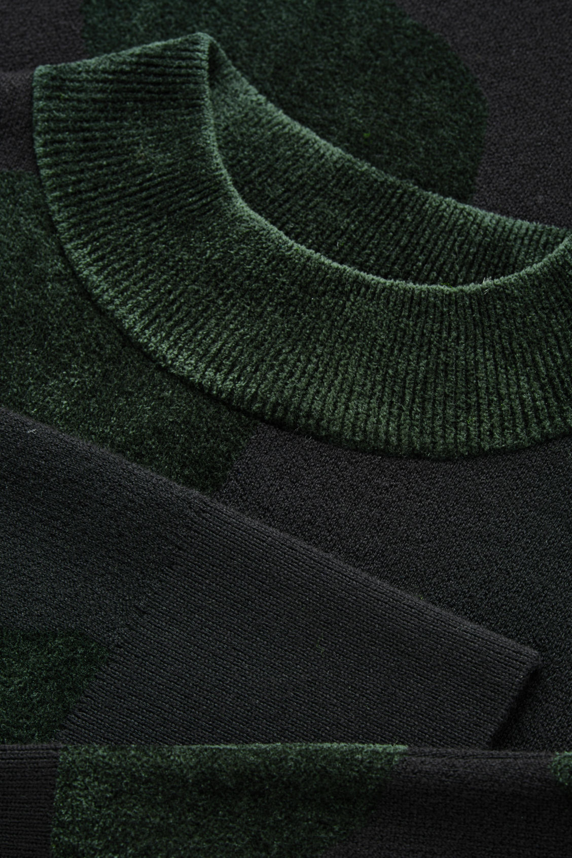 Side image of Cos chenille-pattern tunic jumper in black