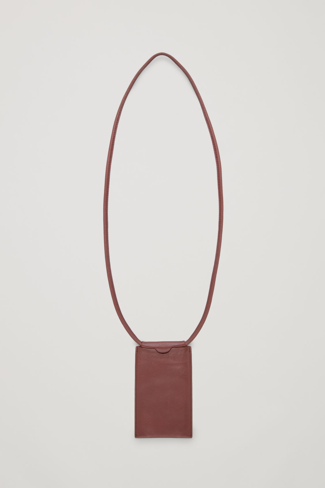 Front image of Cos leather phone pouch in burgundy