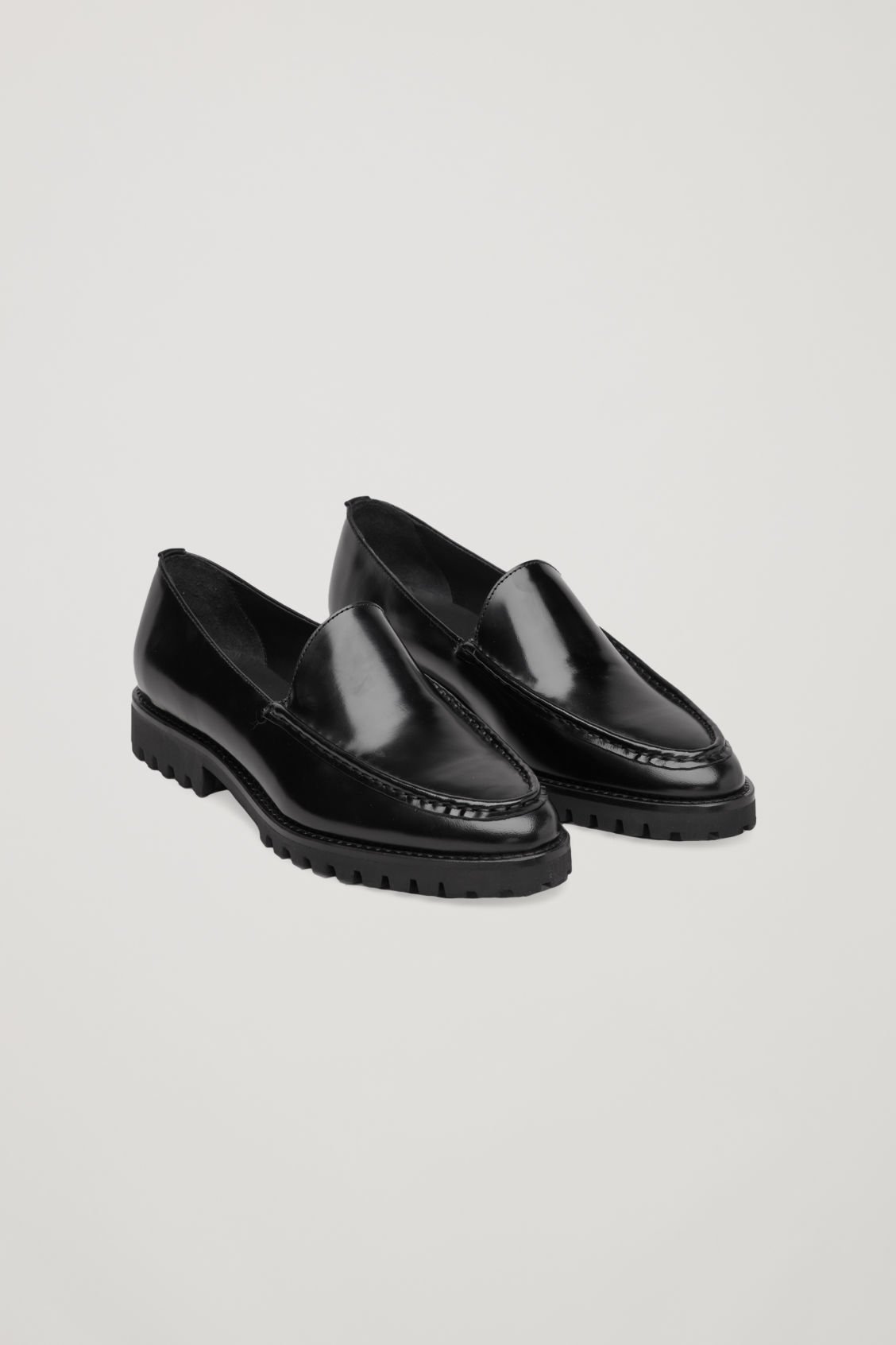 Front image of Cos ridged-sole leather loafers in black