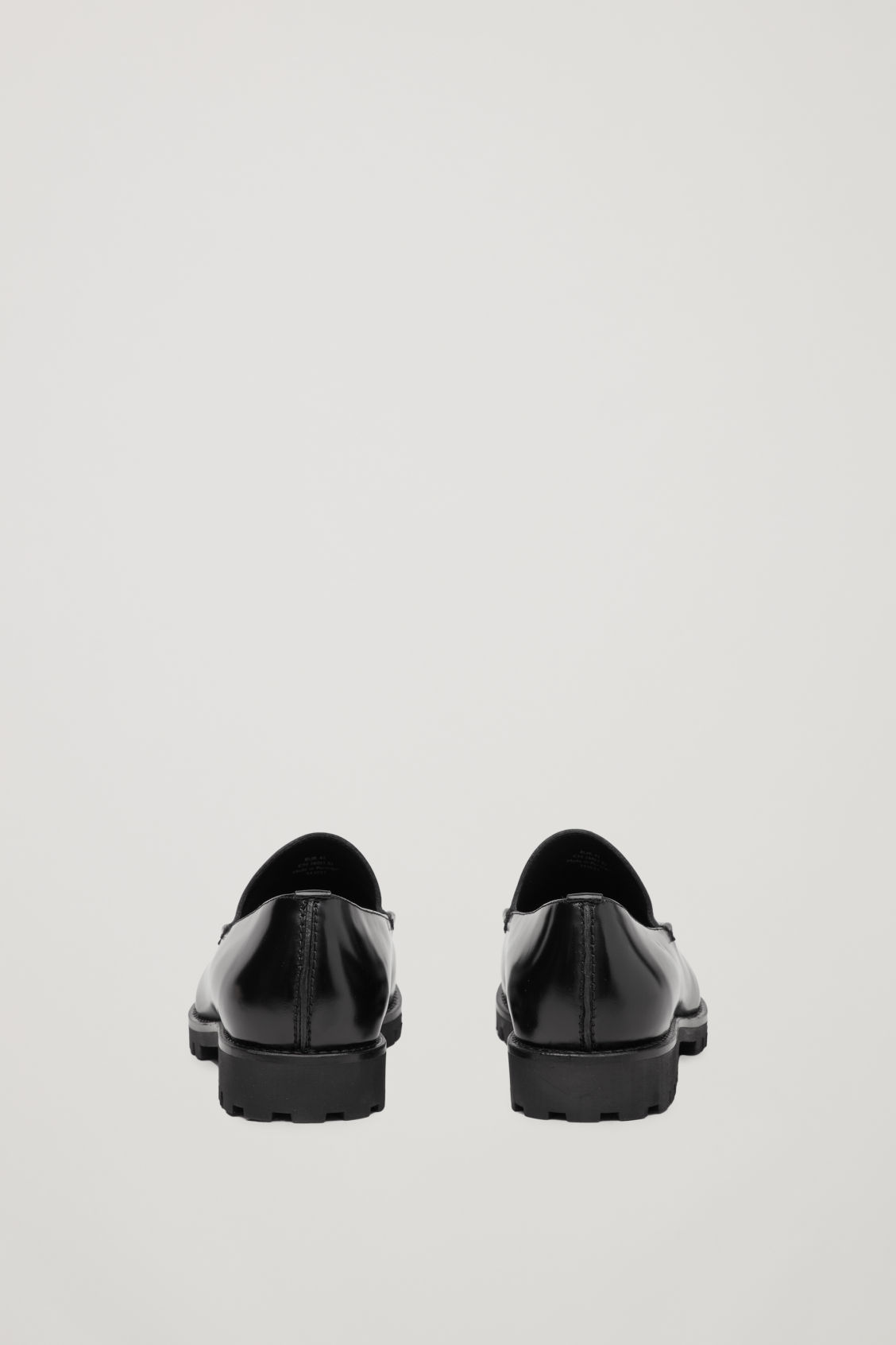 Side image of Cos ridged-sole leather loafers in black