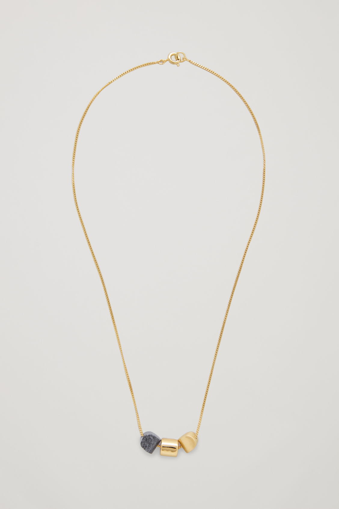 Front image of Cos mixed pendant short necklace in gold