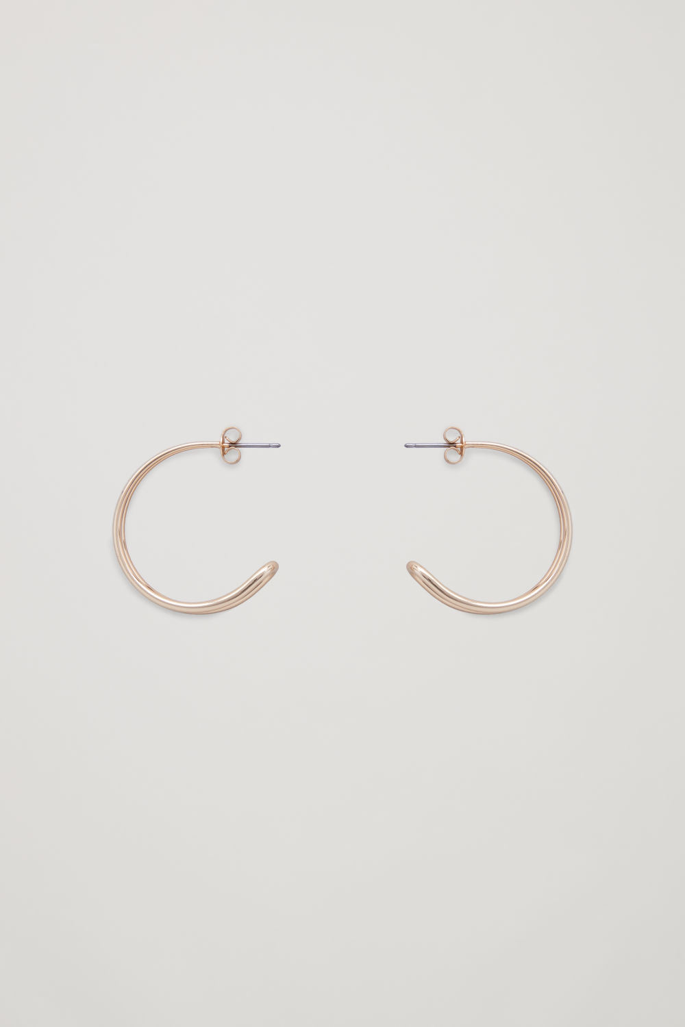 Front image of Cos gradual rounded-layer hoops in gold