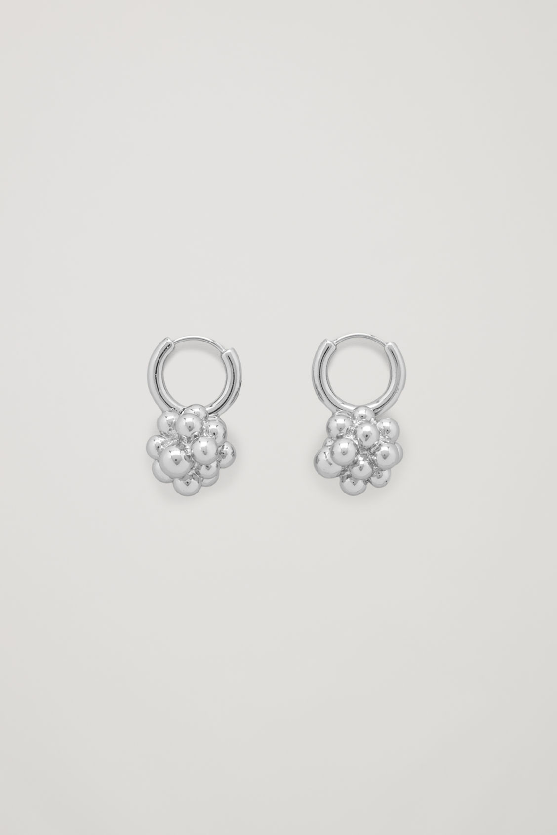 Front image of Cos cluster shape earrings in silver