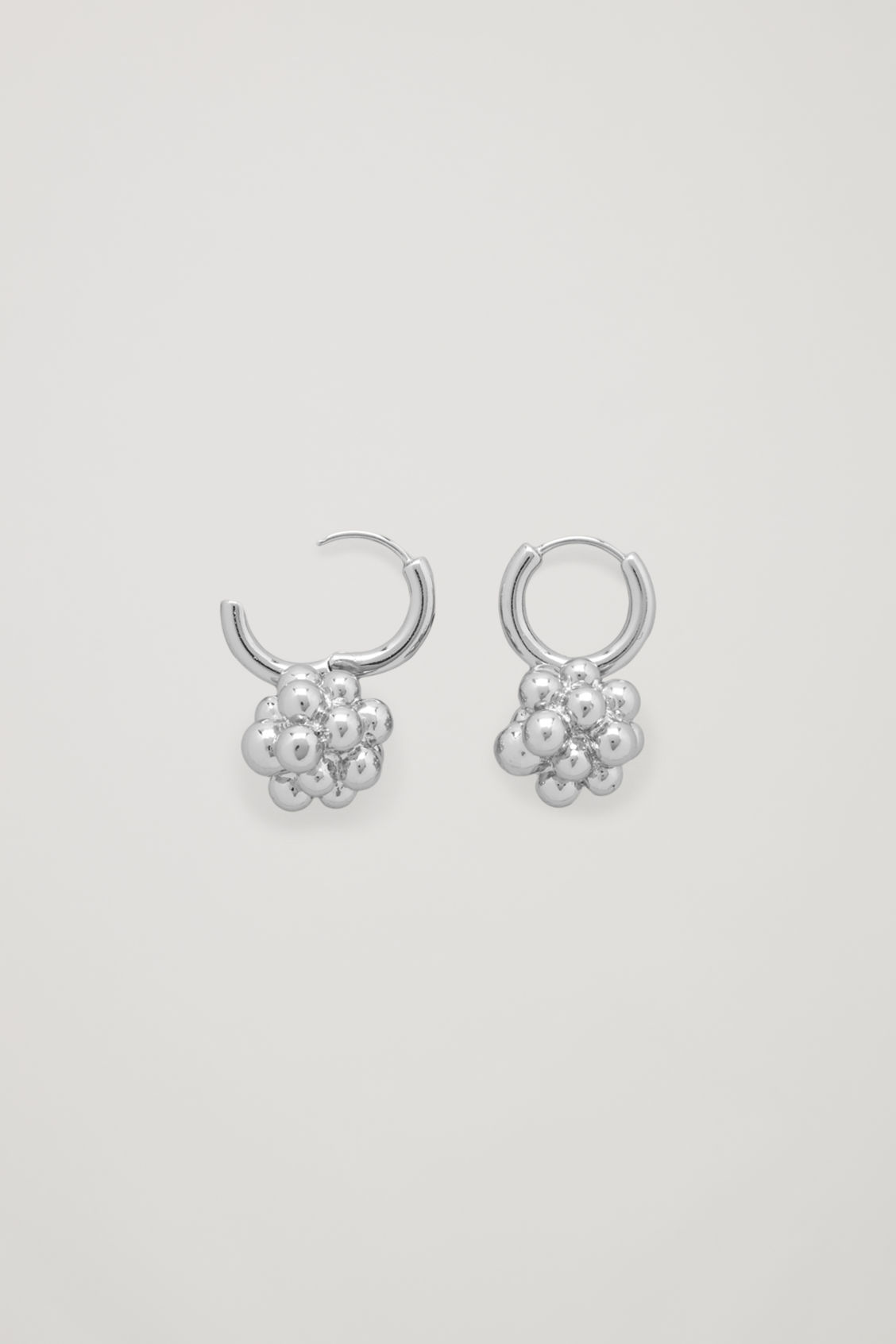 Side image of Cos cluster shape earrings in silver