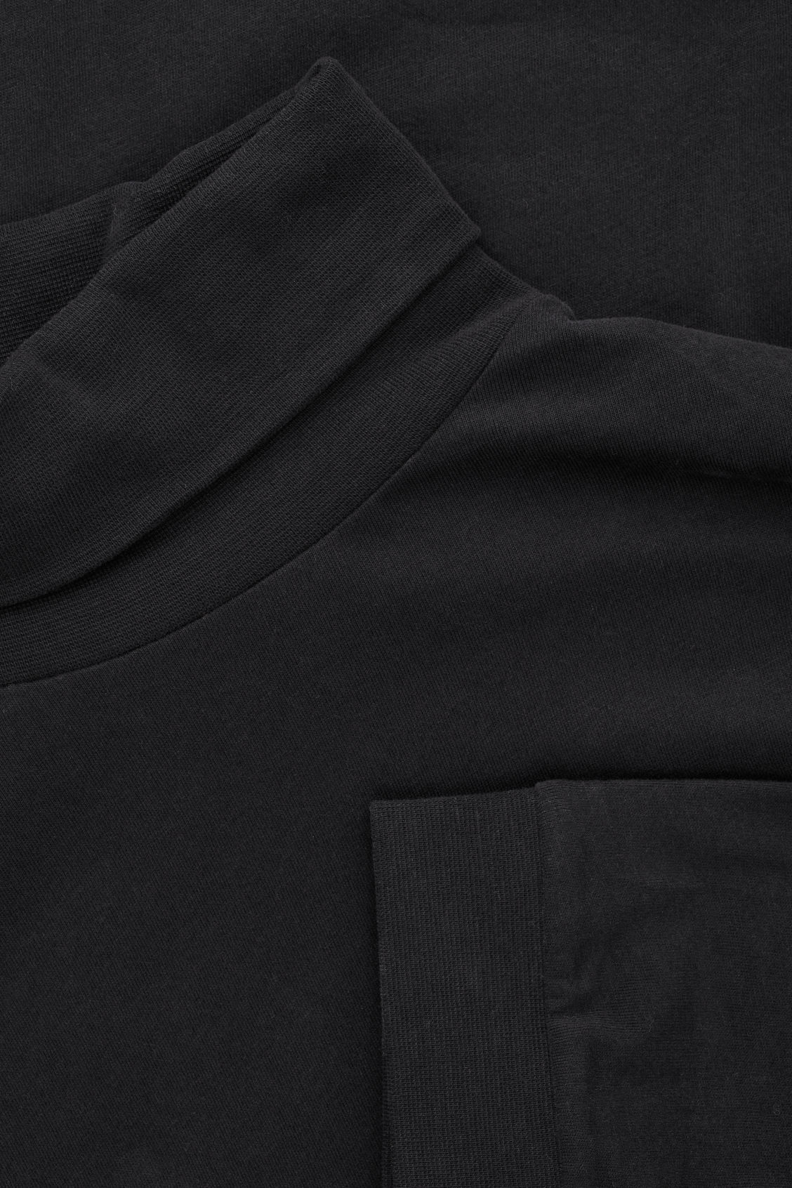 Side image of Cos cotton roll-neck  jumper in black