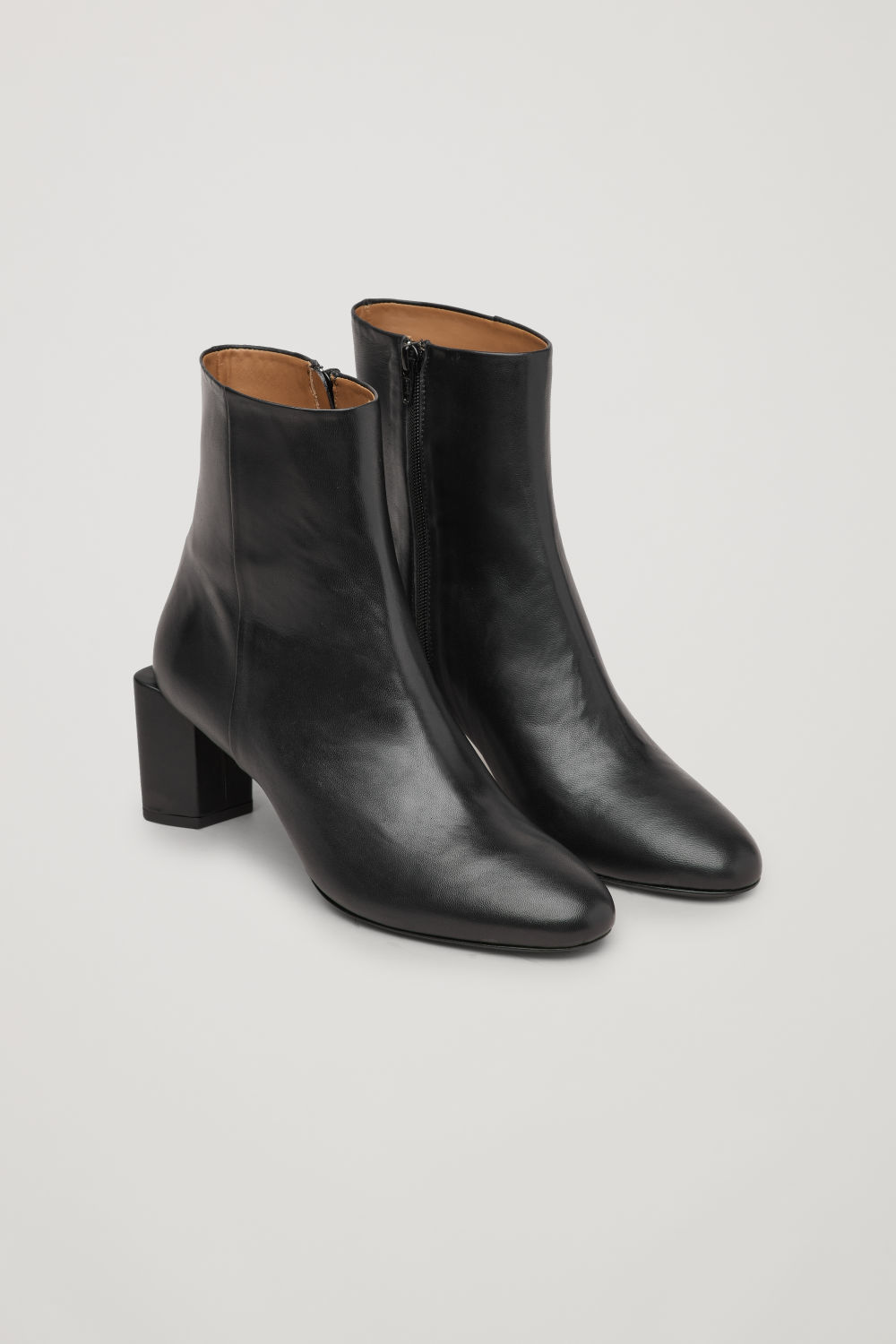 SCULPTURAL LEATHER ANKLE BOOTS