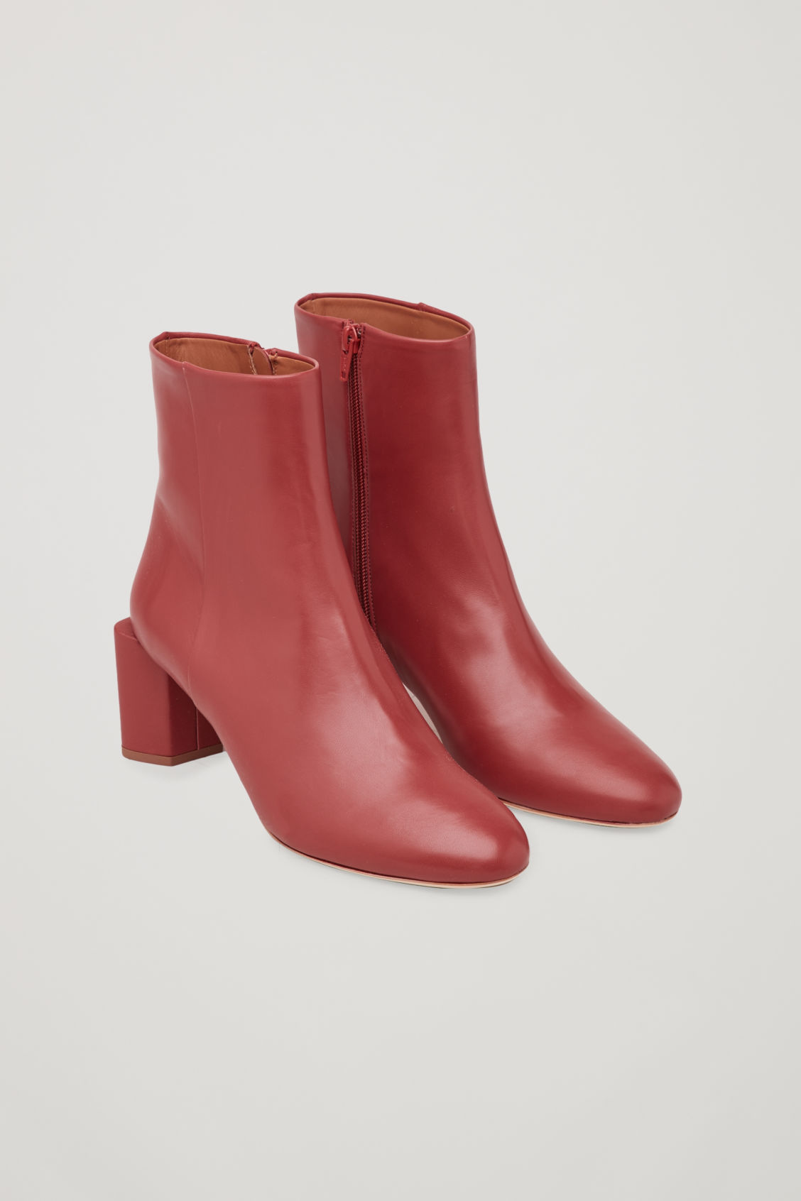 Front image of Cos sculptural leather ankle boots in red