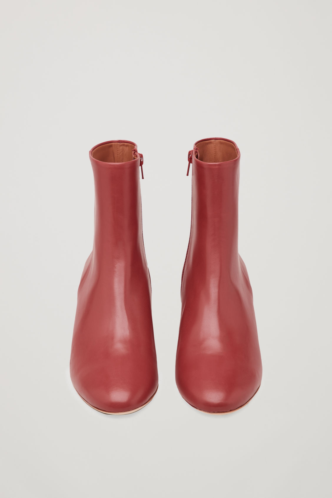 Side image of Cos sculptural leather ankle boots in red