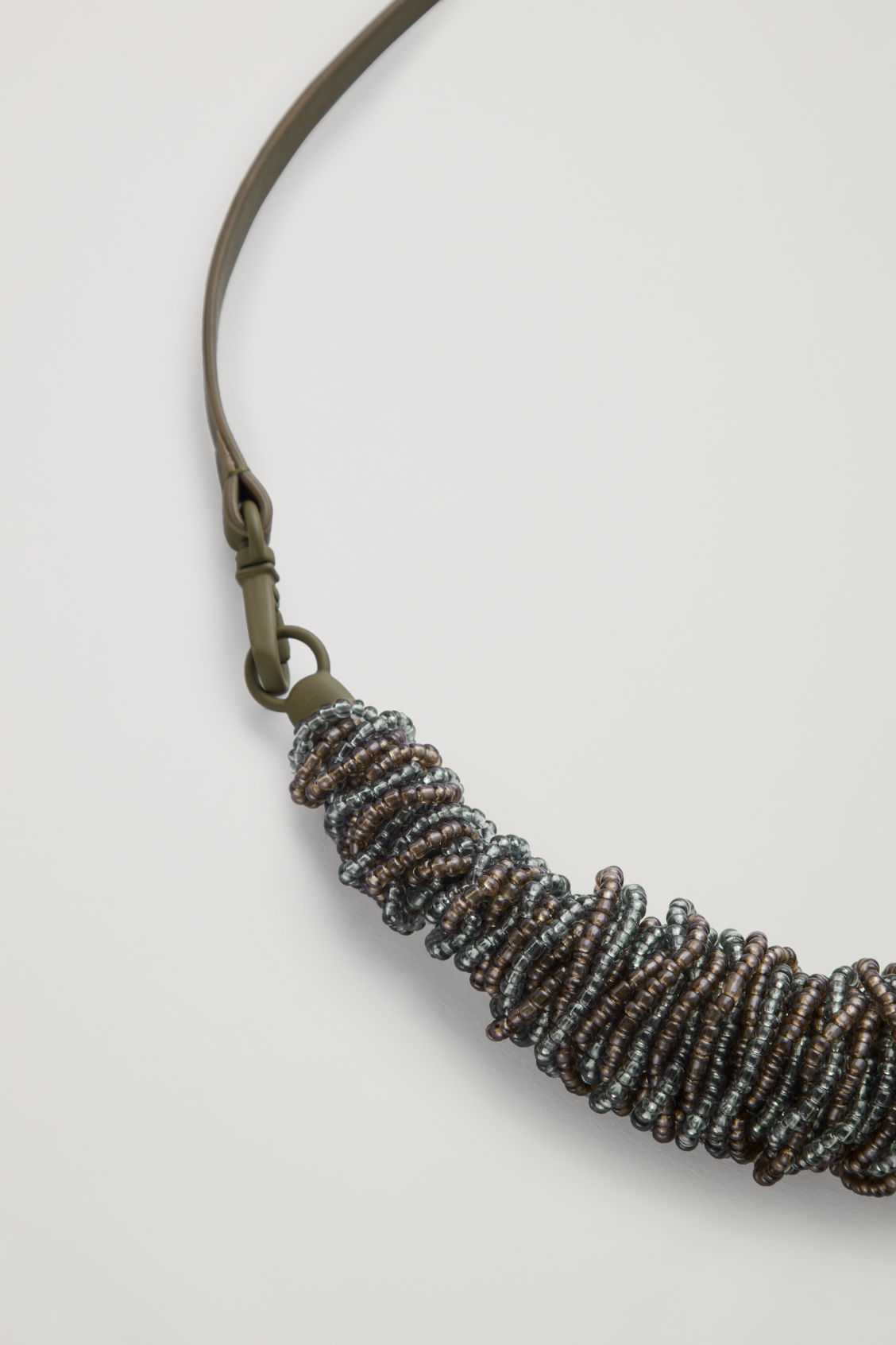 Side image of Cos leather beaded necklace  in green