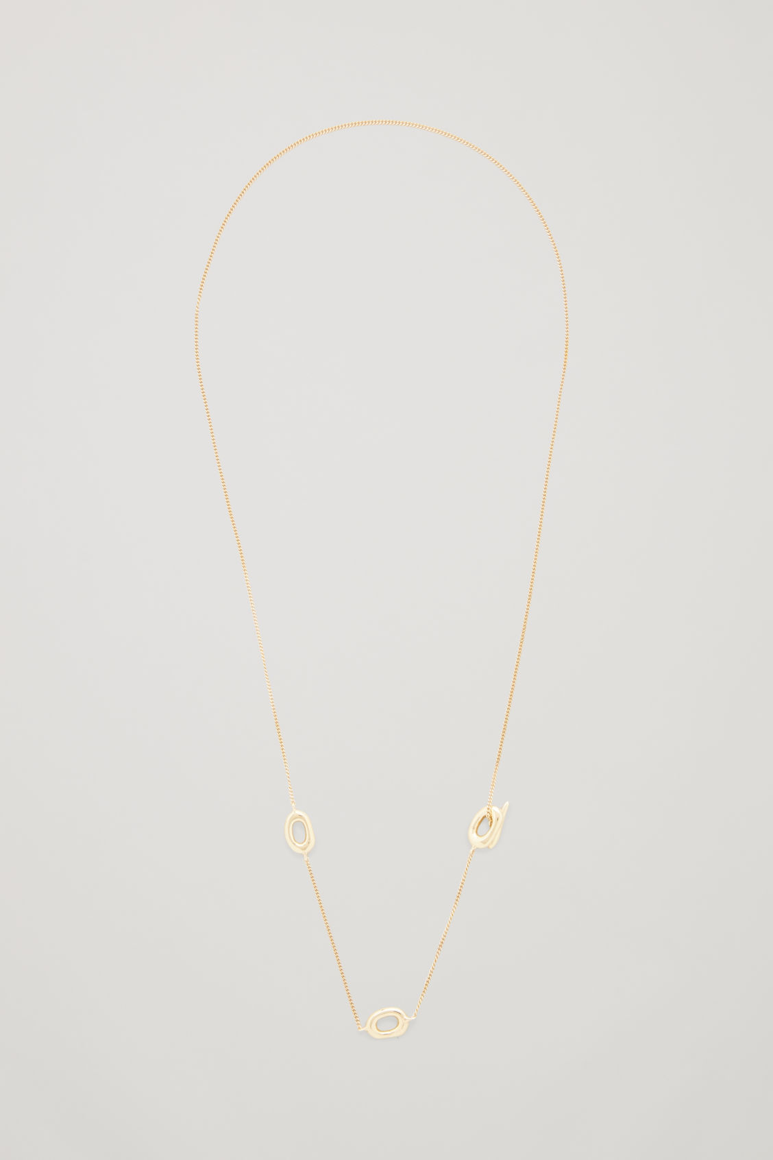 Front image of Cos gold-plated lariat necklace in gold