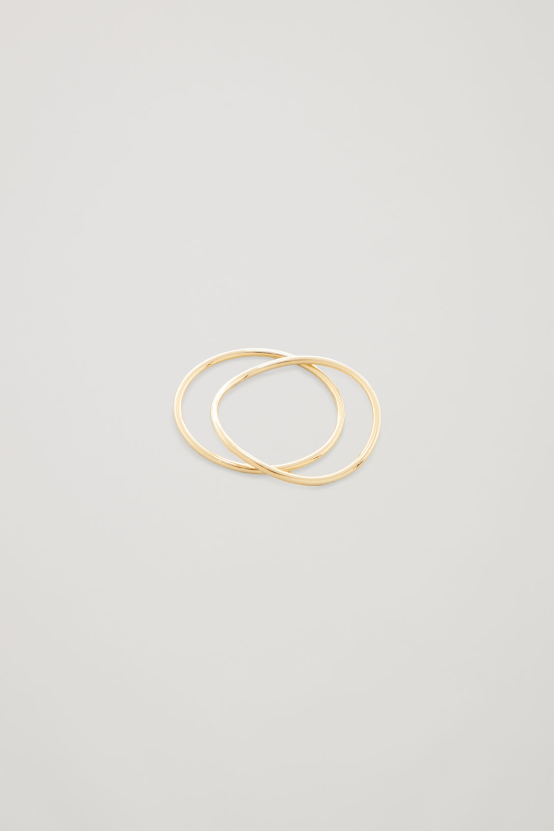 Side image of Cos gold-plated stacking rings in gold