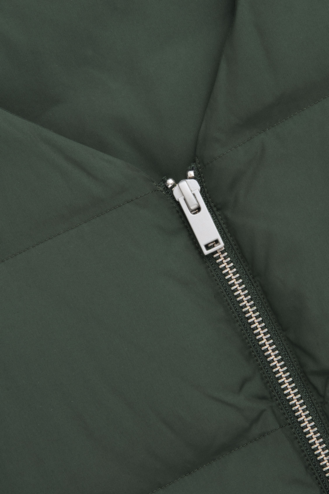 Side image of Cos v-neck padded gilet  in green