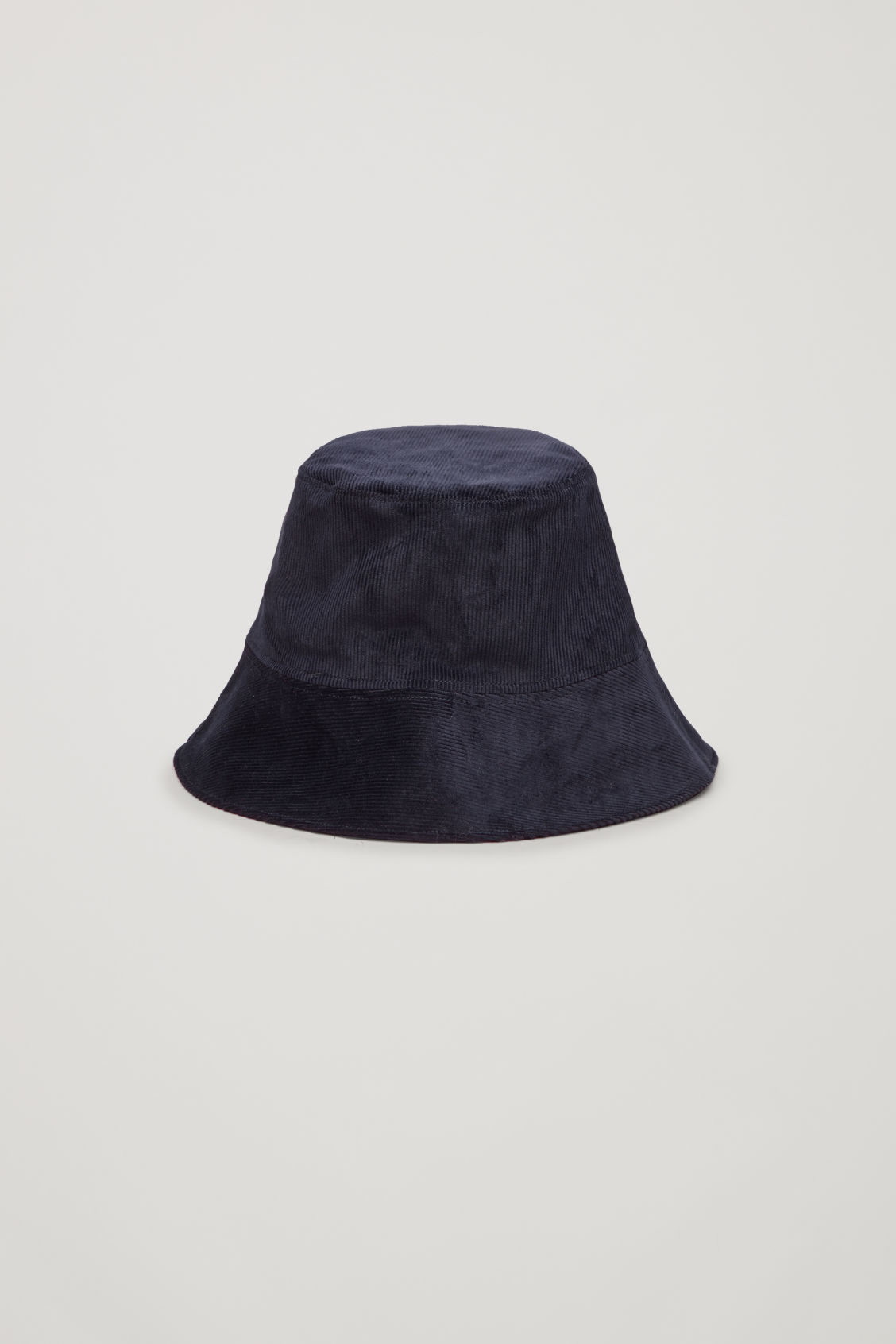 Side image of Cos corduroy bucket hat in blue