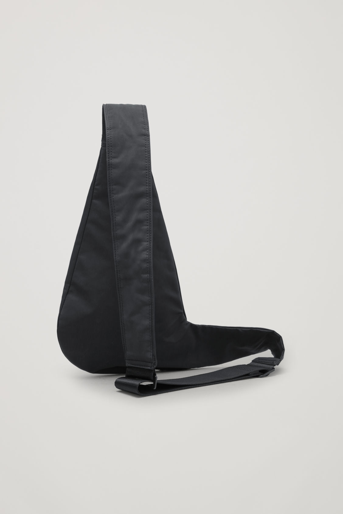Side image of Cos one-shoulder nylon bag  in black