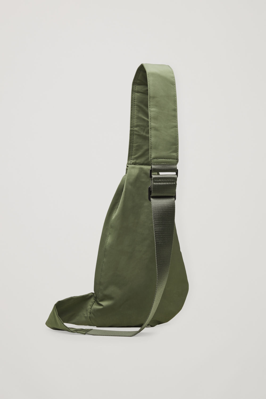 Side image of Cos one-shoulder nylon bag  in green