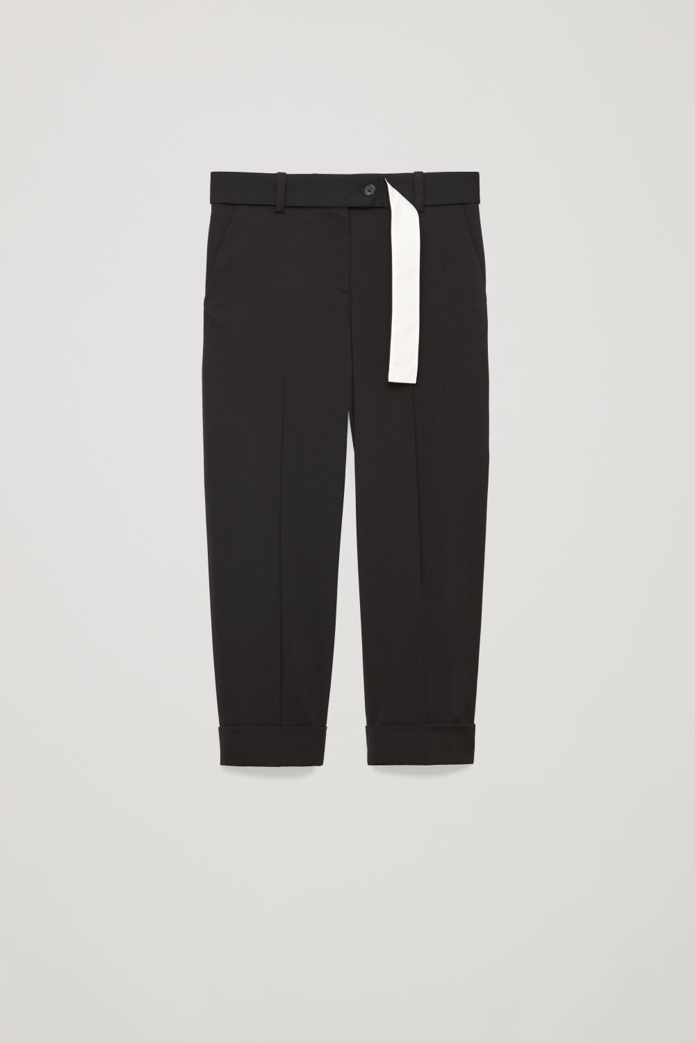 Front image of Cos belted turn-up wool trousers in black
