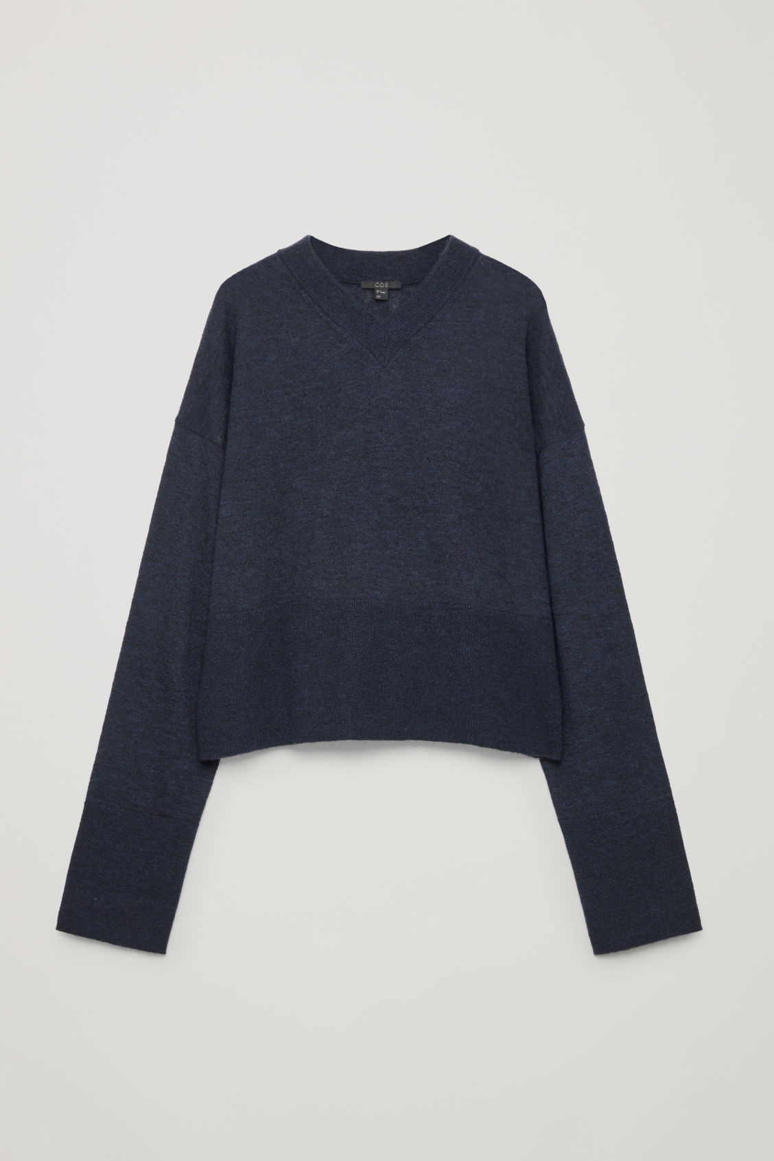 Front image of Cos boxy wool v-neck jumper in blue
