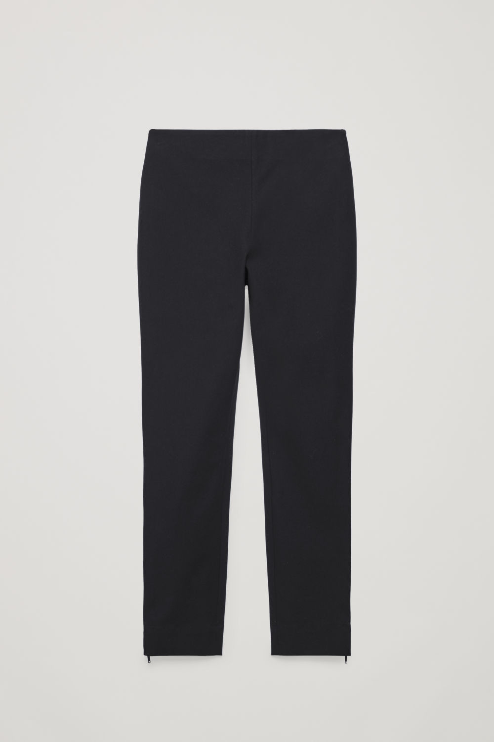 Front image of Cos skinny legging trousers in black