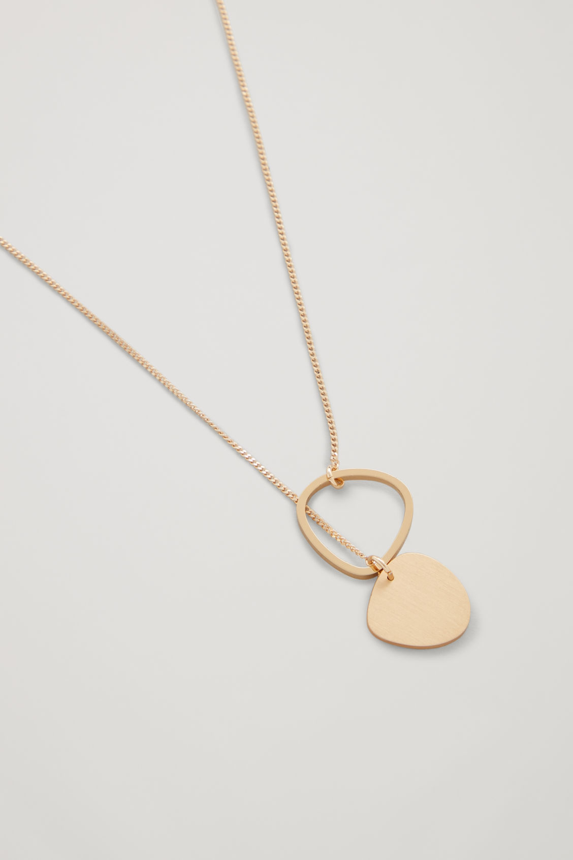 Side image of Cos short mixed-shape necklace  in gold