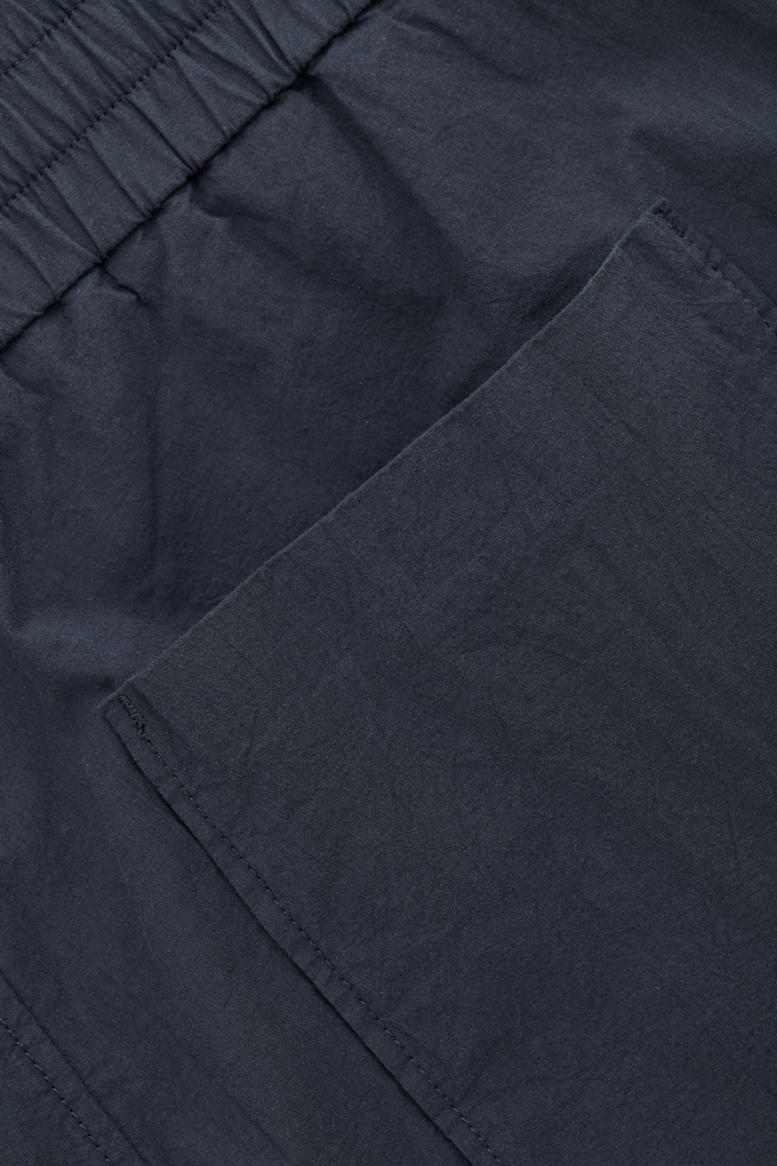 Side image of Cos relaxed elastic-waist trousers in blue