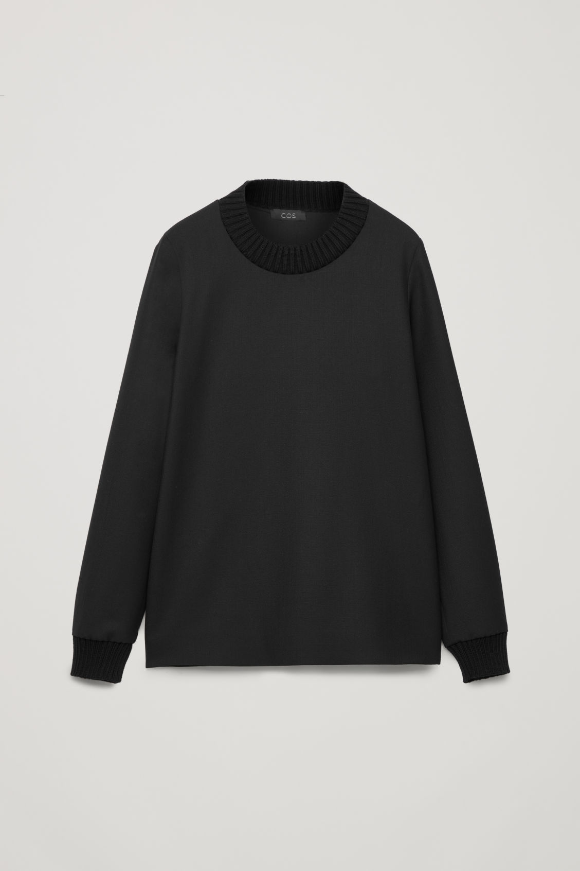 Front image of Cos top with knitted edges in black